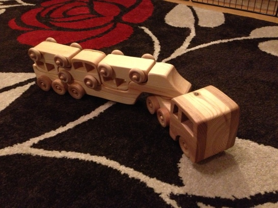 A gaggle of wooden vehicles